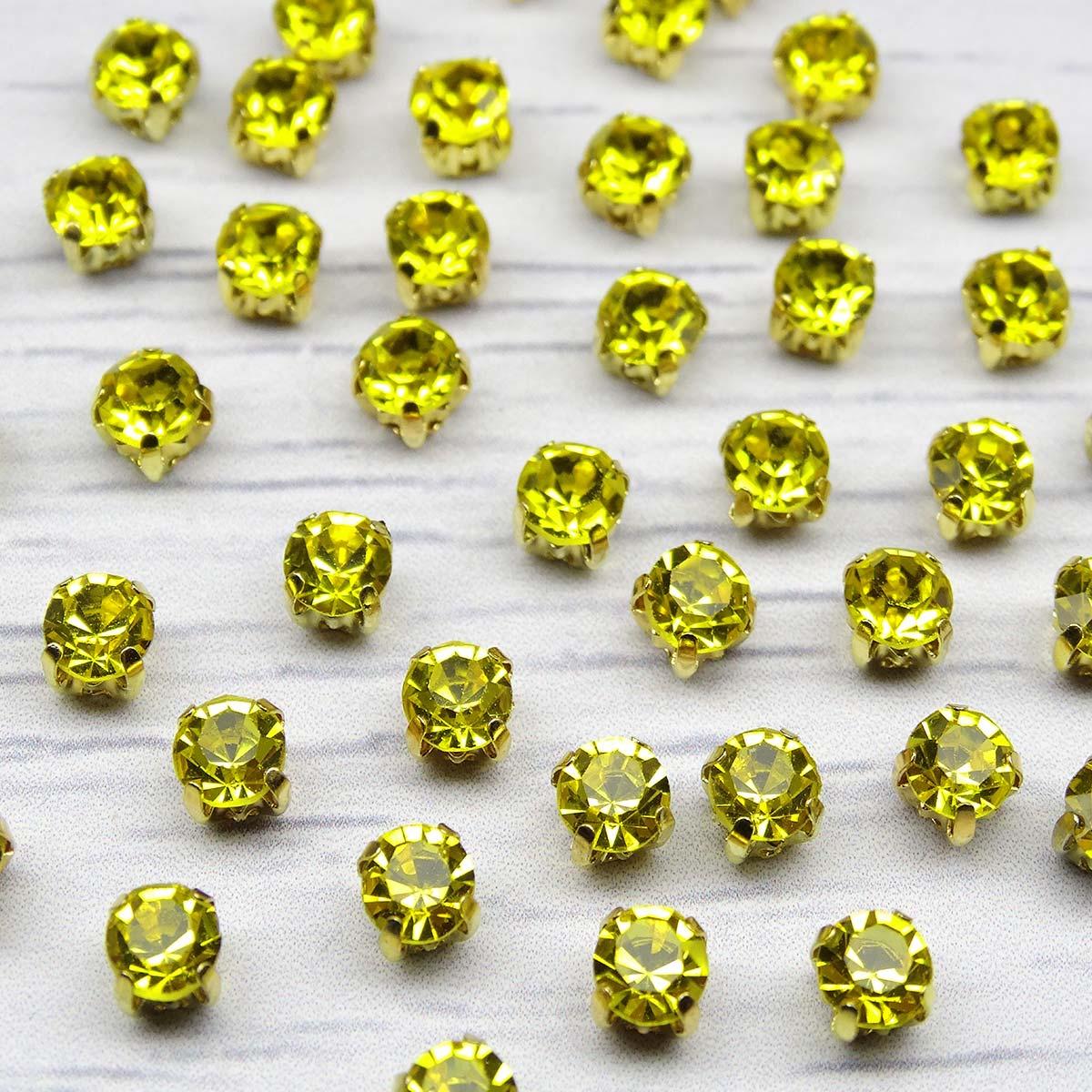 ЗЦ017НН44 Хрустальные стразы в цапах круглые (золото) цитрин 4х4 мм, 29-30 шт/упак Астра