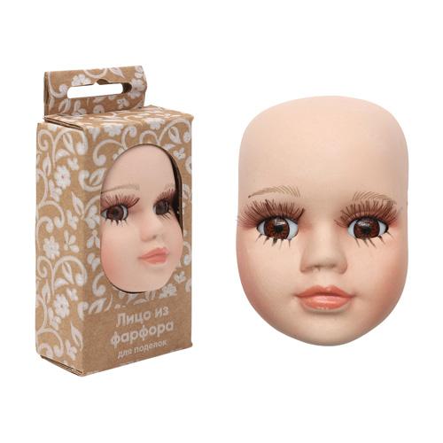 27040 Фарфоровая заготовка 'Лицо для куклы' 5,0см*6,5см*2,4см гл.-карие